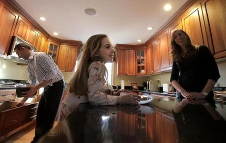 "Jason Manekas recently prepared dinner for his daughter Perry, 5. ""I didn't want to go into [parenting] unless I had . . . an equal partner,"" his wife, Jillian, said."